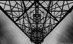Made of steel (Nicholas Rossetto) Tags: steel acciaio traliccio antenna tower ripetitore geometria geometry simmetria symmetry linee lines bianconero blackwhite bianco nero black white piramide pyramid nikon d7100 18140mm nicholasrossetto