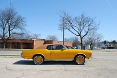 1969 Oldsmobile Cutlass (Cragin Spring) Tags: midwest milwaukee milwaukeewi milwaukeewisconsin wisconsin wi urban unitedstates usa unitedstatesofamerica city olds oldsmobilecutlass 1969 yellow wheels oldsmobile