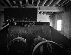 Derelict machinery Harts Flour Mill Port Adelaide (mernamora) Tags: derelict hartsmill flour mill analogue bw monochrome old antique machines machinery discover patent