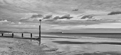 Look for the bear (Greatdog) Tags: dorset bw clouds beach bournemouth landscape