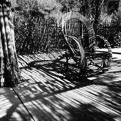 shaded (johngpt) Tags: shadows appleiphone5 lowylensblackeysextrafinefilmnoflash chairs abqbotanicgardens hipstamatic albuquerque newmexico unitedstates us fence