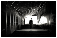 Dans le ventre de la baleine (mildiou2) Tags: tunnel structure metal woman light step shadow black white spain