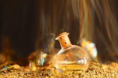 "Macro Mondays  theme ""Intentional Blur"" (giancarlo_darrigo) Tags: macromondays macro intentionalblur gold longexposure nikon nikond7000 motion colors 7dwf 7dayswithflickr sand sabbia arena potion bottle bottiglia hmm"