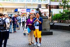 At Shibuya Hachiko Square : ハチ公前広場にて (Dakiny) Tags: 2017 spring april japan tokyo shibuya station shibuyastation city street people portrait man woman couple group nikon d7000 sigma 1770mm f284 dc macro os hsm sigma1770mmf284dcmacrooshsm nikonclubit